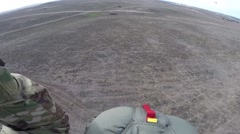 SPAIN ZARAGOZA, NOVEMBER 2015, Parachute Trooper Land On Ground Stock Footage