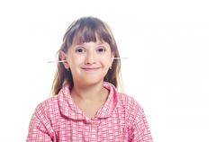 The girl cleans ears Q-tips Stock Photos