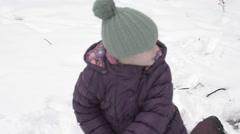 Children in the Winter Channel Snowballs - stock footage