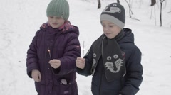Boy and Girl in Winter Are Holding Sparklers Stock Footage