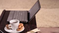 A laptop and a cup of coffee - panning shot Stock Footage
