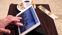 A side view of man working with tablet - panning shot Stock Footage