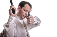 The man aims from the weapon Stock Photos