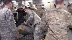 ZARAGOZA SPAIN, NOVEMBER 2015, Medium shot Soldier Take Parachutes - stock footage
