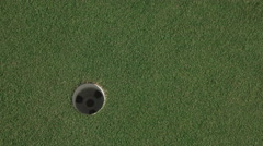Golf ball enter hole . Stock Footage