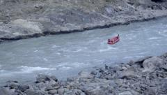 Holy water of the Ganges river and rafting boats Stock Footage