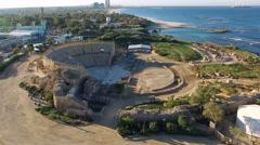 Aerial Israel. Landing near Caesarea Amphitheater blue sky Mediterranean sea Stock Footage