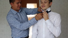 Happy groom wedding preparations Stock Footage
