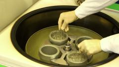 A man uses big centrifuge more closely - stock footage
