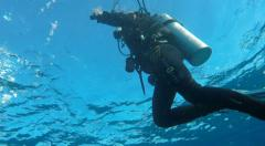 Divers at surface from underwater - Scuba Diving Stock Footage