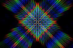 Diffraction of light from the LED array on the crossed diffraction gratings - stock photo
