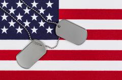 Close up of military identification tags on USA Flag - stock photo