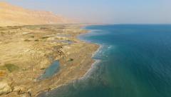 Dead sea coastline with sinkholes - Aerial footage Stock Footage