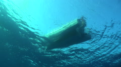 Dive boat floating at sunlight - view from underwater Stock Footage