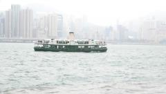 Ferry boat on Victoria harbour water, cloudy view, tracking shot Stock Footage