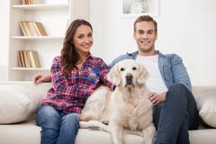 Attractive girlfriend and boyfriend with pretty animal Stock Photos
