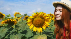 Panning shot of beautiful woman happy and enjoy in sunflower field Stock Footage