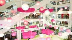Pink decor hand around white mall atrium hall, parallax shot Stock Footage