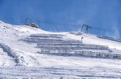 Ski lift and snow fences in Austrian Alps Stock Photos