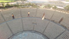 Pan inside Caesarea Amphitheater Coliseum Stock Footage