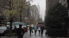 gloomy rainy day in Manhattan NYC with Empire State Building covered in fog - stock footage
