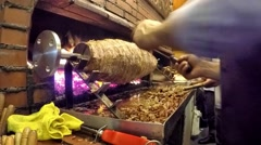 Man prepares turkish cag kebab on Sirkeci District in Istanbul, Turkey Stock Footage