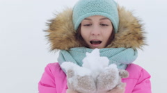 Blowing Snow. Beauty Joyful Teenage Model Girl having fun in winter park Stock Footage