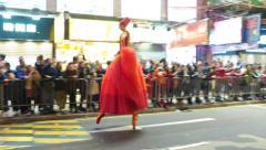 Ballerina on stilts walk and dance on night street, ceremonial parade - stock footage