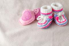 child booties on soft felt backgound - stock photo