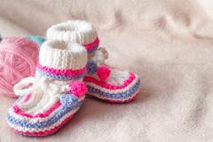 Child booties on soft felt backgound Stock Photos