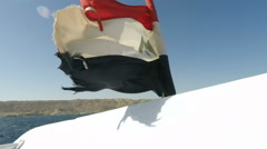 National Flag of Egypt on boat in wind - stock footage