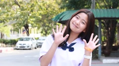 Thai student teen beautiful girl run and bye bye. Stock Footage