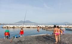 Teenagers jumping into the sea in Naples - stock photo