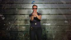 Female Police Detective draws her gun Stock Footage