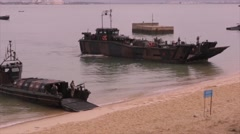 TROIA Portugal, November 2015, Landing Ships At Beach Unload Vehicle - stock footage