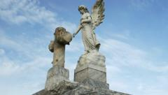 Dolly around a cemetery angel on top of a tomb in New Orleans Stock Footage