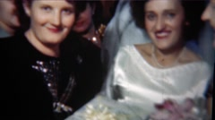 1954: Bride embarrassingly smiles while getting gift from loud mouth friend. - stock footage