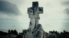 Monument of woman hanging on a cross in Metairie Cemetery New Orleans Stock Footage