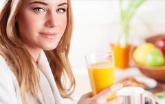 Happy healthy girl drink juice Stock Photos