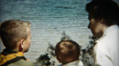 1955: Mother giving boy scout advice with young baby girl present. CHICAGO Stock Footage
