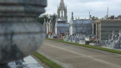 Reveal from urn to tombs in Metairie Cemetery New Orleans Stock Footage