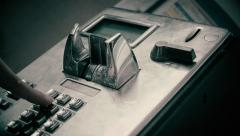 Old public phone working with coins - stock footage