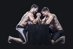 Two sportsmen armwrestling Stock Photos