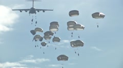 ZARAGOZA SPAIN, NOVEMBER 2015, Close Up Paratroopers Jump Out C17 Aircraft Stock Footage