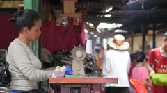 Stock Video Footage of Woman tailor at work in market,Phnom Penh,Cambodia
