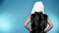 Woman joyful girl in bikini fur vest cap, winter fashion 4K Stock Footage