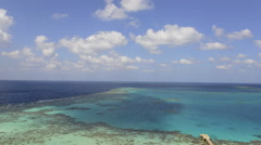 Time lapse of tropical coral reef and clouds - Sanganeb reef, Red Sea, Sudan Stock Footage