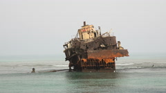 Rusty unknown shipwreck over the sea - Red Sea, Sudan Stock Footage