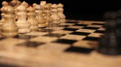 Side angle shot of a chess board and it´s pieces lined up, first move... Stock Footage