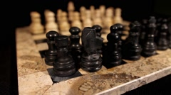 Side shot of a chess board with it´s figures lined up Stock Footage